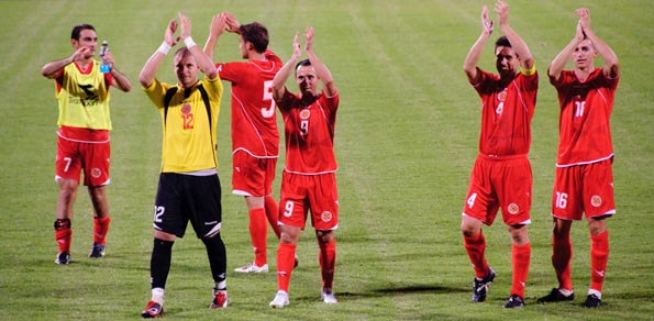 Didn't we do well lads?  Malta's national team in action.