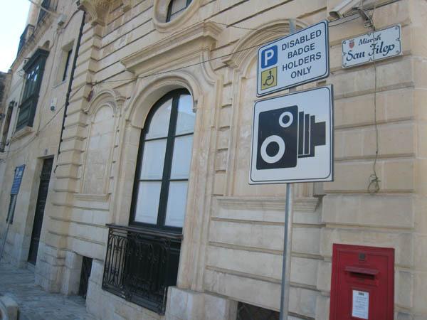Speed camera sign on disabled parking space, Zebbug, Malta